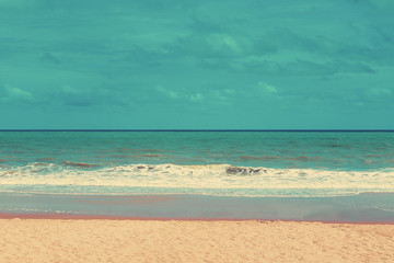 Retro beach and blue sky with vintage tone.