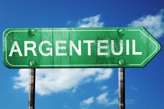 argenteuil road sign, vintage green with clouds background