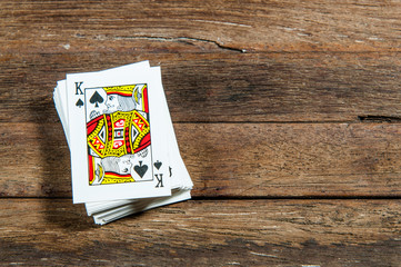 Cards on wooden table.