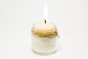 Burning candle on white