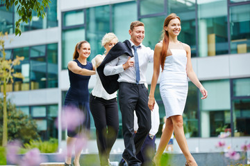 Four business people walking as a team