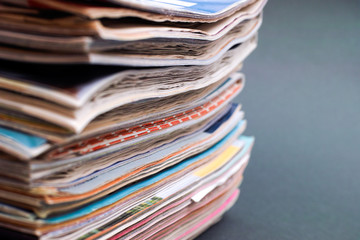 Stack of magazines on dark green background