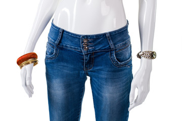 Girl's blue skinny-fit jeans. Mannequin wearing skinny jeans. New pants on store showcase. High-quality denim clothes.