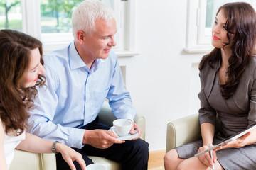 Advisor giving investment advice to senior couple