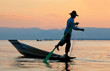 An unidentified Intha fisherman catches fish for food on Inle Lake, Myanmar.
