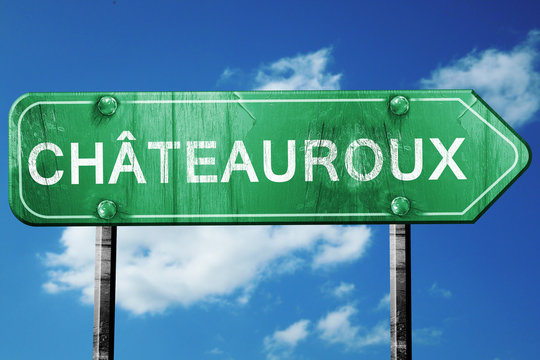 chateauroux road sign, vintage green with clouds background