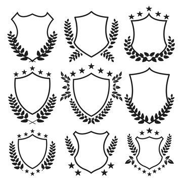 Medieval shields with stars and laurel wreaths set. Vector illustration
