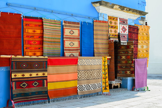 Wall of a local store with traditional Mexican handmade carpets