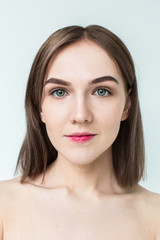 Beauty portrait of young model with middle length hair. Professional nude makeup. Green eyes.