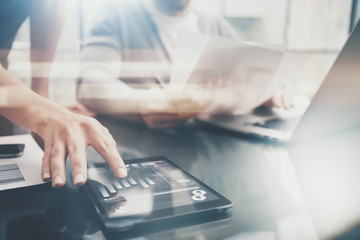 Business situation.Meeting of investment managers.Photo female showing document.Man holding report, using laptop.Working process modern office,discussion startup. Horizontal. Film and bokeh effects