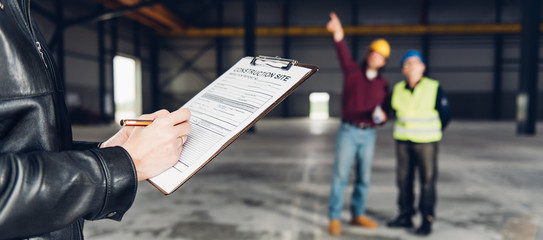 Construction Site Inspector making report