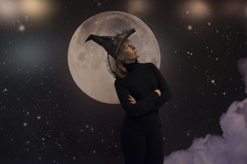Witch, moon and clouds at night on Halloween
