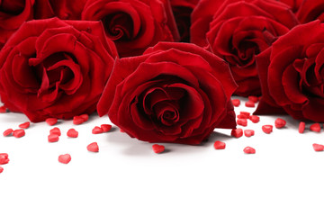 Bouquet of red roses with small hearts isolated on white
