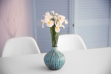 Fresh white irises on dinning table, indoors