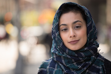 Young woman wearing hijab in city smile face portrait