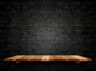 Empty wooden shelfs on pastel grunge black brick wall, Mock up t