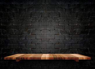 Empty wooden shelfs on pastel grunge black brick wall, Mock up t