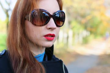 Girl autumn leaves coat sunglasses
