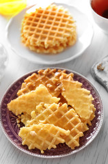 Fresh crumbled waffles on plate