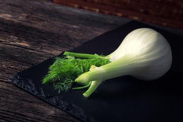 Fresh white fennel on the black plate