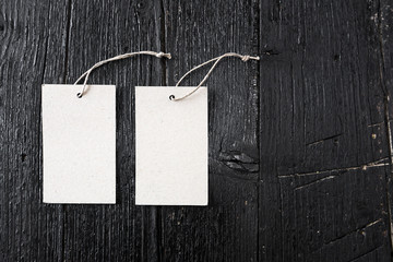 paper badges on wooden background
