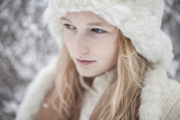 Portrait of young woman in fur hat