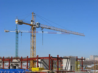 Construction site with tower cranes. Сityscape.