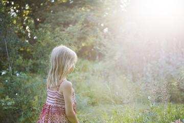 Girl standing in meadow
