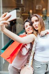 Women making photo after shopping