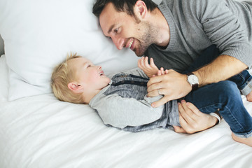 Father with son playing in bedroom