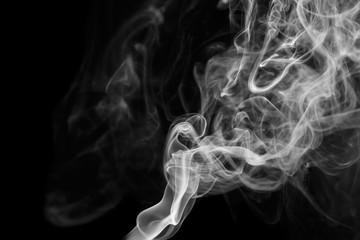 Abstract gray smoke from the incense sticks.