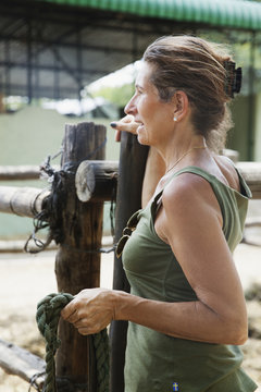 Mature woman holding rope in zoo