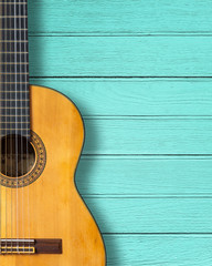 Classic guitar on blue wood vintage background with copy space.