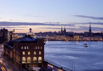 Illuminated city at dusk
