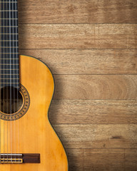 Classic guitar on vintage wood background with copy space.