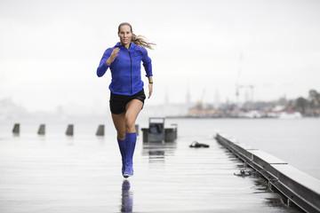Woman running at sea
