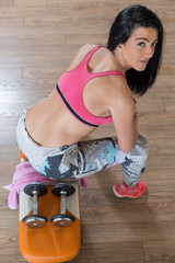 top view of attractive fitness woman, trained female body, lifes