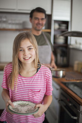 Daughter with father in kitchen