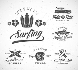 Vector Retro Style Surfing Labels, Logo Templates or T-shirt Graphic Design Featuring Surfboards, Surf Woodie Car, Motorcycle Silhouette, Helmet and Flowers. Good for Posters, Cards, etc. With Shabby
