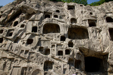 Longmen Grottoes with Buddha's figures are Starting with the Northern Wei Dynasty in 493 AD, Luoyang, China.