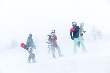 Men walking with snowboard on snowy day