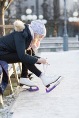 Woman putting ice skates on