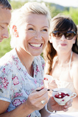 Smiling woman eating desert