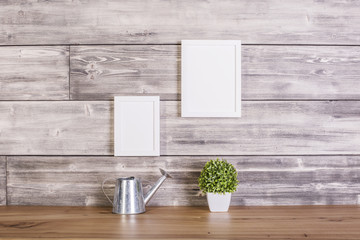 Blank frames on wooden backgrounf