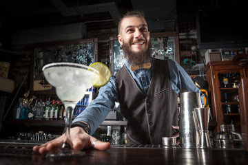 Barman serving cocktail.