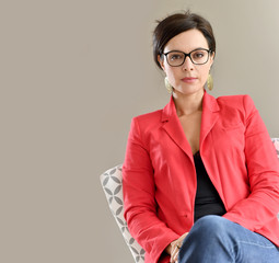 Portrait of beautiful dark-haired woman with red jacket