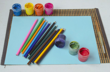 colored pencils, brushes, paints, paper