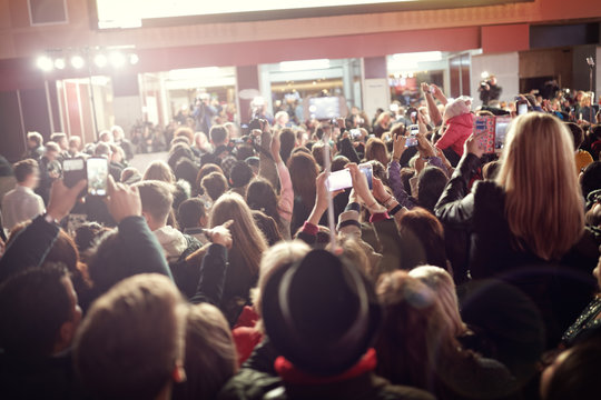 Crowd and fans at red carpet film premiere
