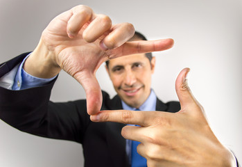 businessman measuring with hands