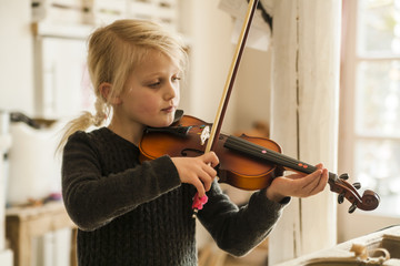 Blond girl playing violin